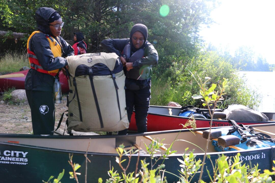 Sisterhood Boutique participants preparing for Boundary Waters canoe trip