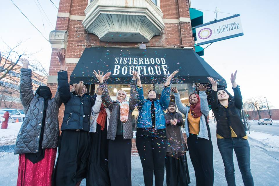 Staff and youth in front of Sisterhood Boutique
