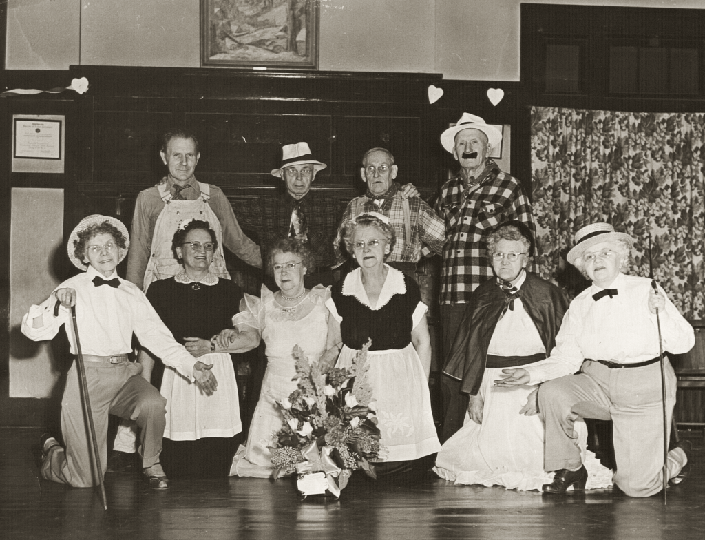 Settlement house community members dressed up for performance