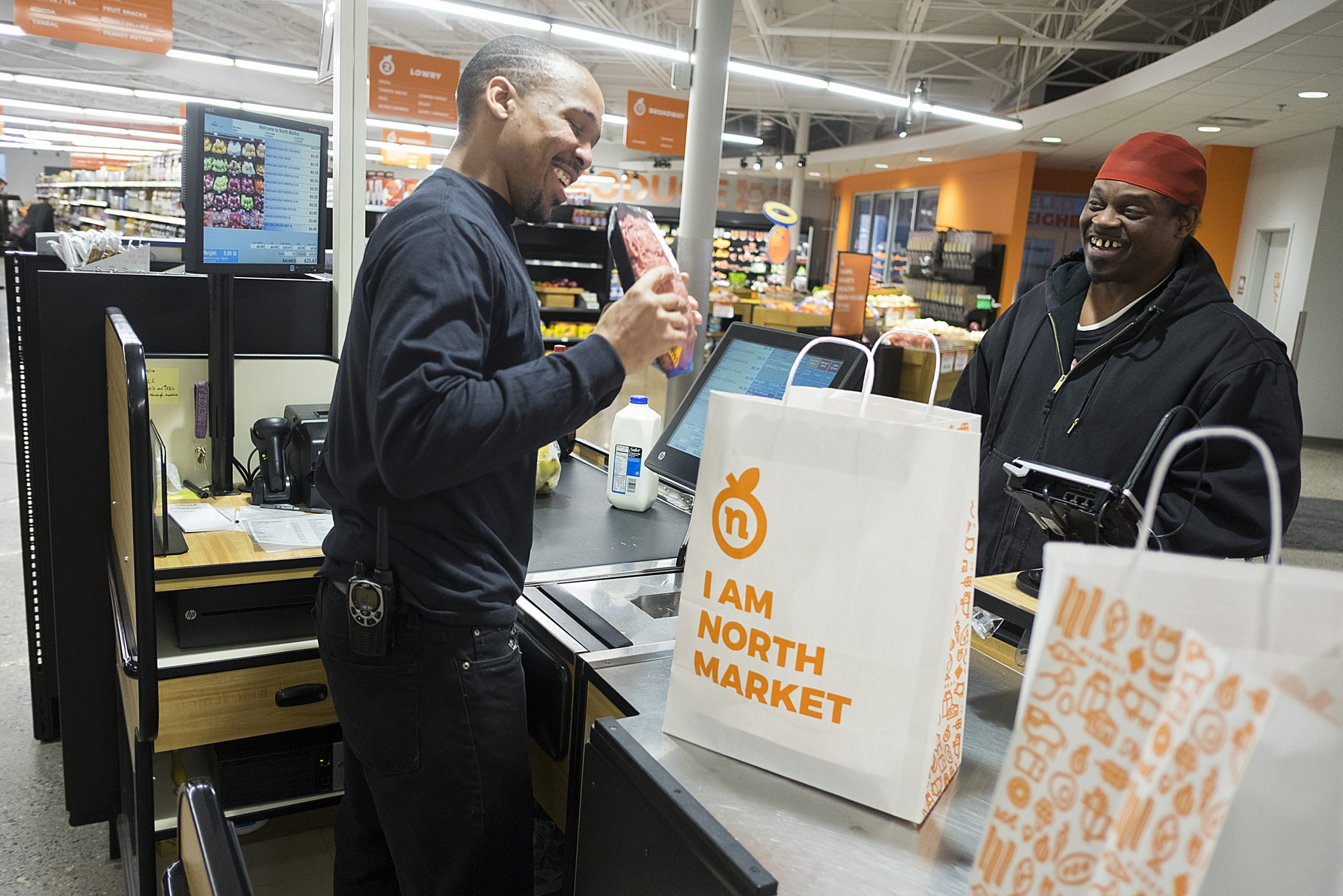 Cashier and customer in check-out line at North Market