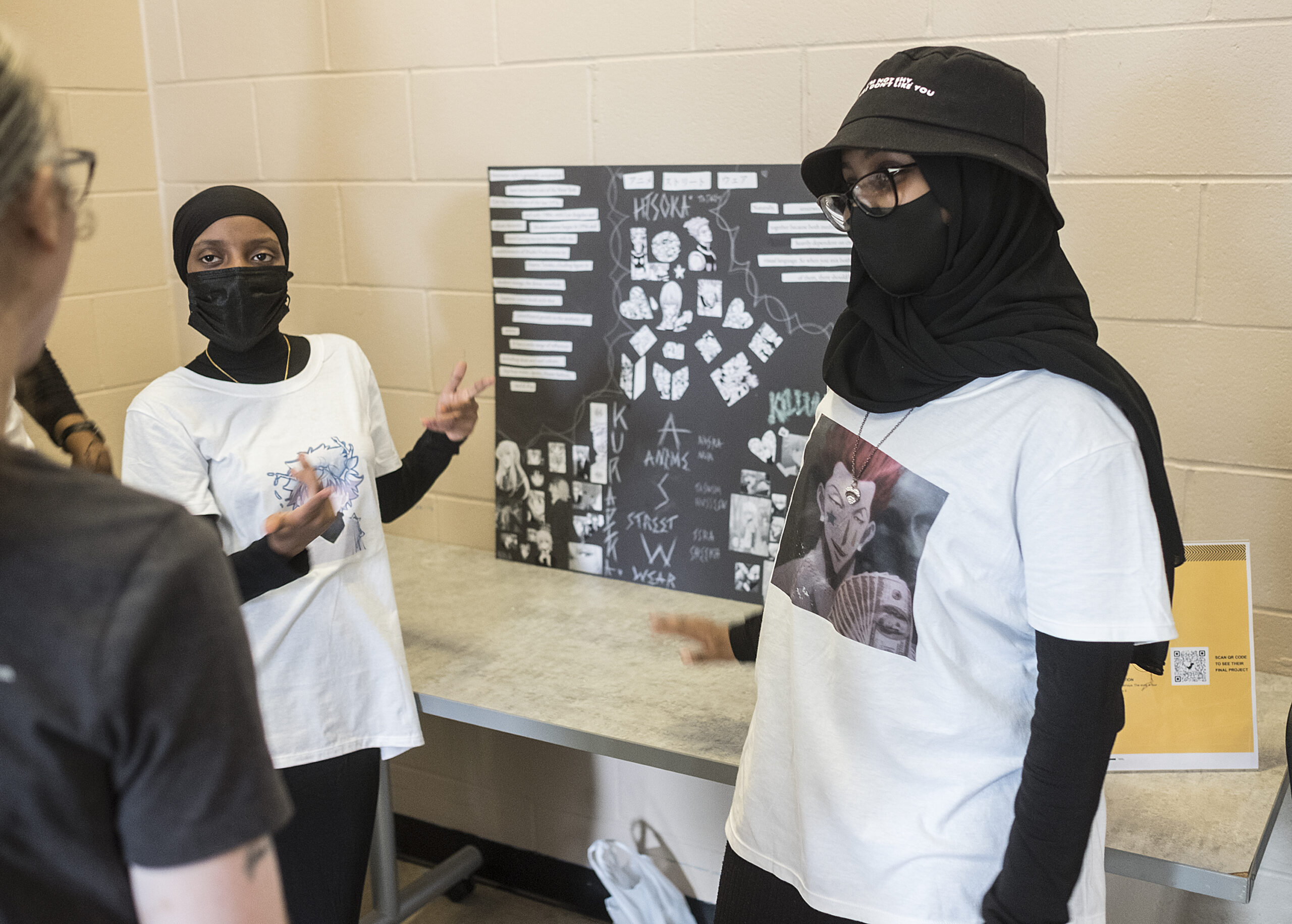 Young women displaying their summer work at Brian Coyle Center